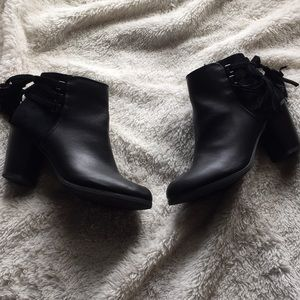 Black ankle boots with tassels